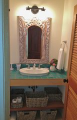 Vieques Island villa photo - The master bath is bright and fully tiled with baskets for your stuff