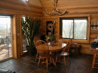 Dining room next to the kitchen and living area - Mesa Verde cabin vacation rental photo