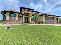 Brand New Custom Gorgeous Waterfront Home ~ Screened Heated Pool and Spa, Dock