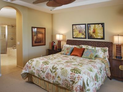 Beautifully appointed master bedroom with Cal King bed and double sink bathroom.