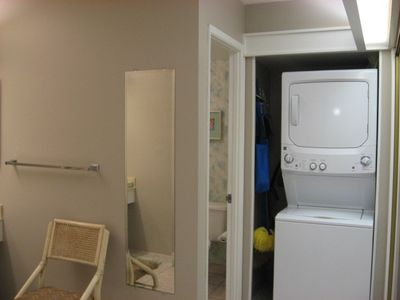 View to the Washer/Dryer and separate Bath, Shower and Toilet
