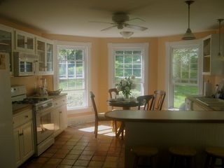 Wytheville farmhouse photo - Large, open and airy the kitchen has a breakfast nook, dishwasher, and gas stove
