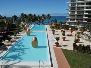 Puerto Vallarta condo photo - 2 of 3 POOLS GOING TOWARDS BEACH FROM POOL TO WATERS EDGE 50 METERS