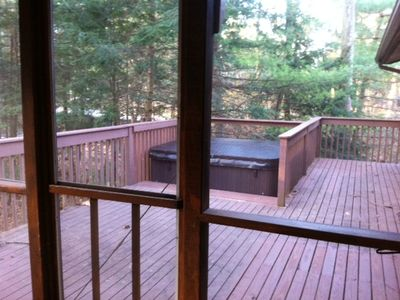 Hot tub as seen from screened in porch. Door to Master beedroom on far right.
