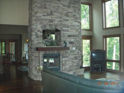 View of double sided fireplace from Family Room on the main level.
