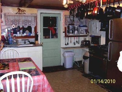 Fully equipped eat in Kitchen between formal dining rm & outside covered deck.