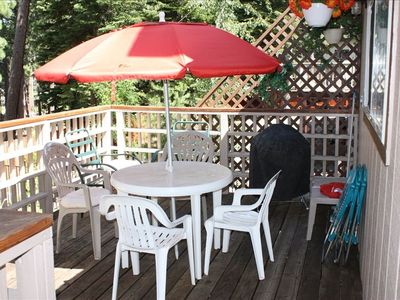 deck with both gas and charcoal grills