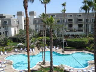 Oceanside condo photo - Resort-style Lagoon Shaped Swimming Pool with lots of seating
