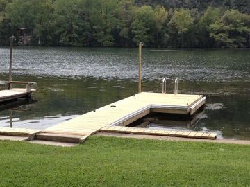 Newly rebuilt dock with ladder and night light at end.