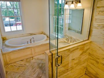 Master Bath Features Whirlpool With Water Views, Walk-In Glass Shower