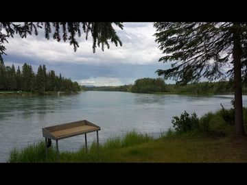 Soldotna cabin rental - Kenai River with fish cleaning table.