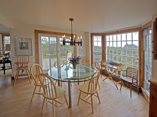 Tom Nevers house photo - Dining area with bay window and large deck