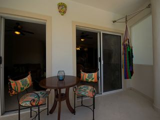 Playacar condo photo - Large terrace with table and chairs. There's a hammock too.