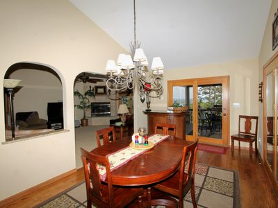 Lots of natural light in the dining area with great views of deck and trees!