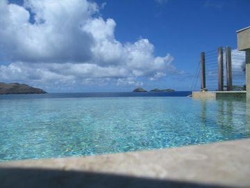 Infinity pool with Cays in the back ground..