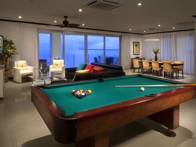 Spacious living room with pool table and amazing ocean views