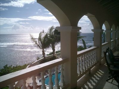 Balcony view overlooking the pool and ocean at Paradise Point, St. Croix
