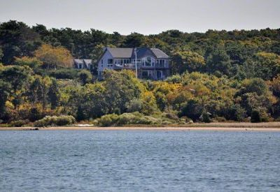 Oak Bluffs house rental - Sandy Point - The House - Sits Serenly Tucked Away In The Wooded Hill Above The Lagoon