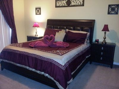 Watersong house rental - Master Bedroom features, walk in closet, patio doors to pool deck,flat screen tv