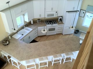 Delton/Gun Lake house photo - This the kitchen from the upstairs sitting room.