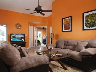 Vacation Homes in Marco Island house photo - Family room with a flat screen TV and sofa sleeper