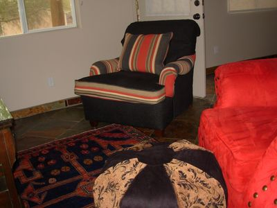 Large comfortable chairs and ottomans to watch TV