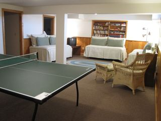 Pocasset house photo - One of lower level seating areas, with Ping Pong. New flat screen TV not shown