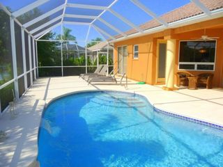 Cape Coral house photo - Screened lanai runs full property width to allow lots of room for sunbathing