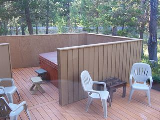 Sunriver house photo - View of the hot tub and deck. Great for sunning or large get togethers.