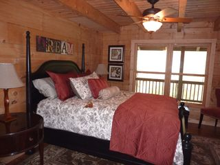 Hot Springs cabin photo - Bedroom with queen bed on main level and private bath.