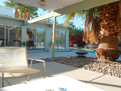the semi-covered patio lounge area by the pool