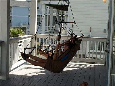 Lounging in a hammock chair on the deck. Hammock downstairs and two chairs up.