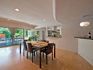 Open floor plan allows for dining with birds eye view of entire house.