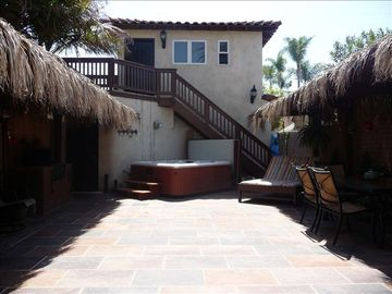 Amazing back courtyard with spa, fire-pit, BBQ, dining table and seating areas