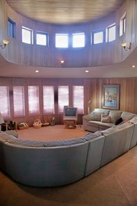 Open front door and see dramatic vaulted ceiling in Living Room with ocean view