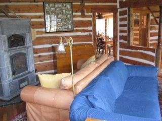 Gardiner cabin photo - Living Room - blue couch comfortable for sleeping. Winter arrangement.