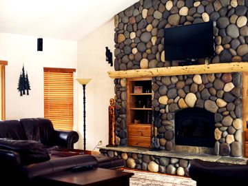 Living room with wood-burning fireplace, 3D home theater, movies, games & books.