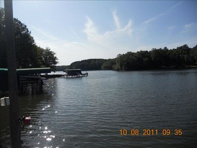 dock view, no wake cove next to largest part of lake, boat ties, ladder for swim