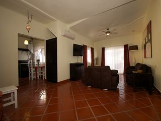 Playa del Carmen condo photo - spacious living area with flat screen TV