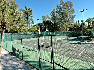 Free use of 2 lighted tennis courts, each with a tall fence so less ball chasing