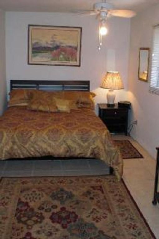 Queen bed in master bedroom.