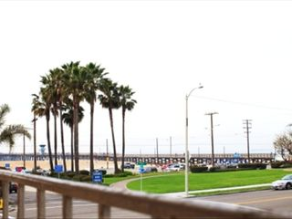 Seal Beach apartment photo - View from outside building to Pier & ocean steps away! Also, beach playground.
