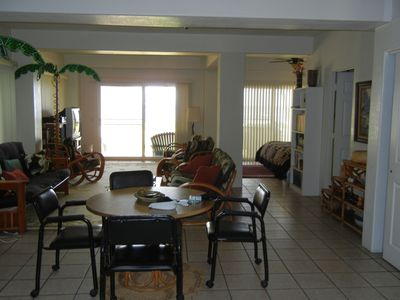 Interior view of Suite with tile floors, 2 sliding glass windows to ocean, 825sq