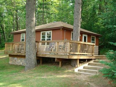 View of cabin and deck for Northwoods wisconsin cabin rentals