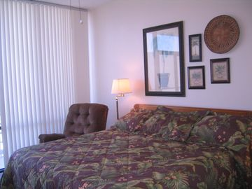 Master bedroom with king bed and recliner for a quiet get away for TV or reading