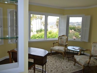 Large seating area in master bedroom with more ocean views.