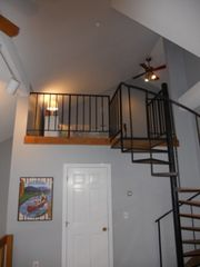 North Conway townhome photo - Spiral stairs from the 2nd floor loft to the sleeping loft.