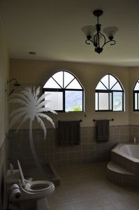 Master suite bathroom. Dual sinks, private shower, tub.