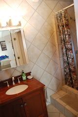 Rockport house photo - Mstr bath-step up, walk in to a fully tiled BIG shower!