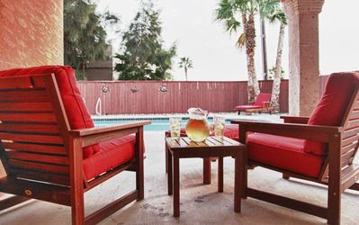 Relax on Patio Chairs by Pool Side